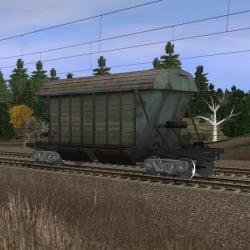 Большой зелёный хоппер для перевозки минеральных удобрений